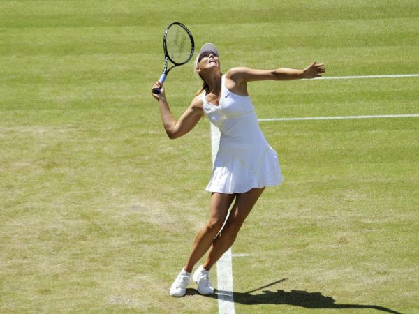 Sharapova drugs ban reduced to 15 months