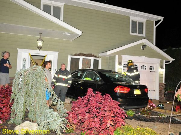 Injuries After Car Crashes Into Long Island House