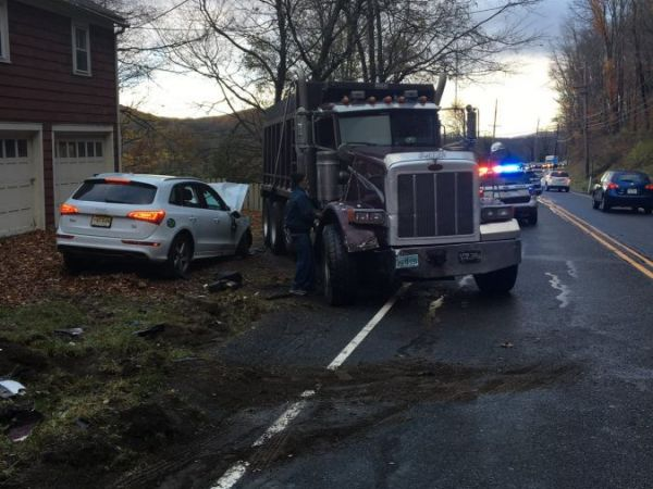 Three Injured After Dump Truck Collides With Audi On Route