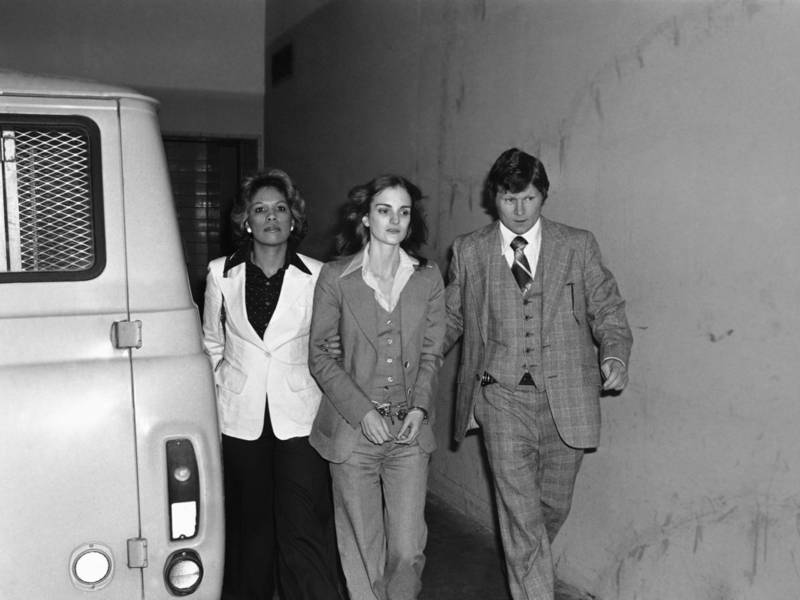 Donald DeFreeze and Patty Hearst leaving the Hibernia Bank in San Francisco  April 15, 1974