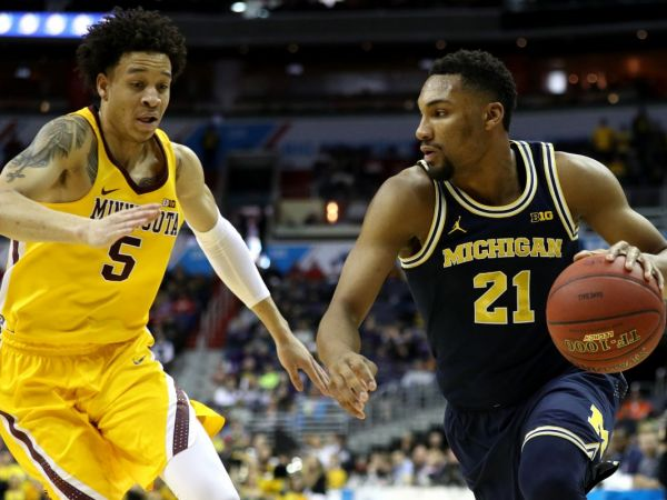 Michigan's magical run is in jeopardy at the half against Louisville