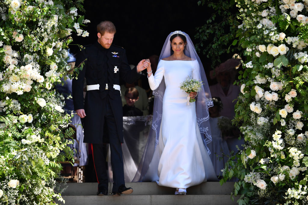 (L-R) Prince Harry, Duke of Sussex and Meghan, Duchess of Sussex leave Windsor Castle in the Ascot Landau carriage during a procession after getting married at St Georges Chapel on May 19, 2018 in Windsor, England. Prince Henry Charles Albert David of Wales marries Ms. Meghan Markle in a service at St George's Chapel inside the grounds of Windsor Castle. Among the guests were 2200 members of the public, the royal family and Ms. Markle's Mother Doria Ragland. (Photo by Chris Jackson/Getty Images)