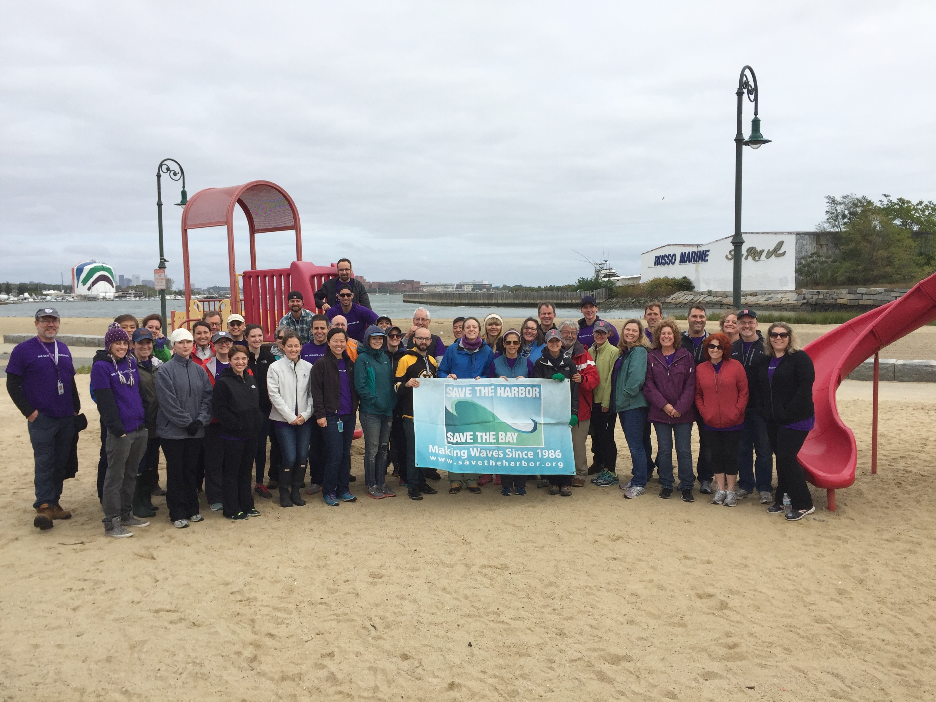 Volunteers From Vertex Pharmaceuticals Joined Save The Harbor Bay And MA Department Of Conservation Recreation To Clean Up Tenean Beach In
