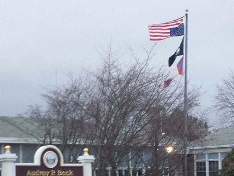 Flag Honoring Vets At Mansfield Municipal Center Flipped