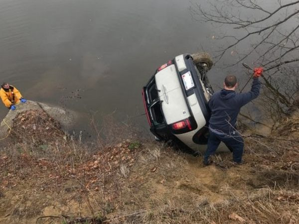 Crew team discovers stolen auto dumped in river