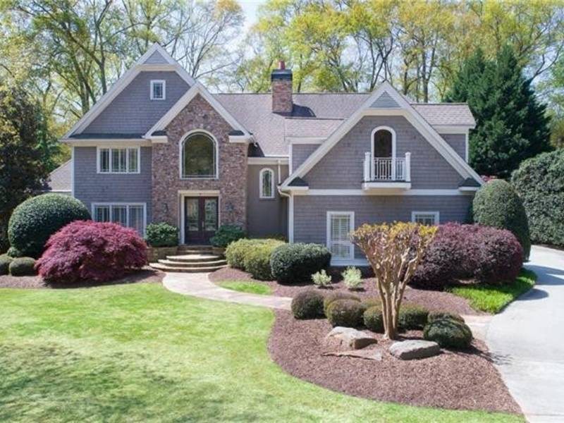 $1.19M Riverfront Home With Fire Pit, Koi Pond, Wet Bar