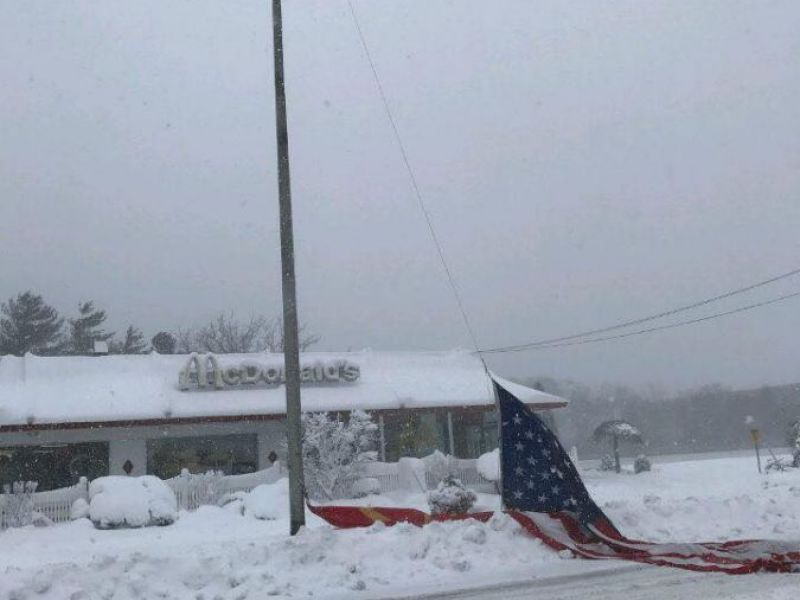 islip fire department rescues american flag found buried in snow