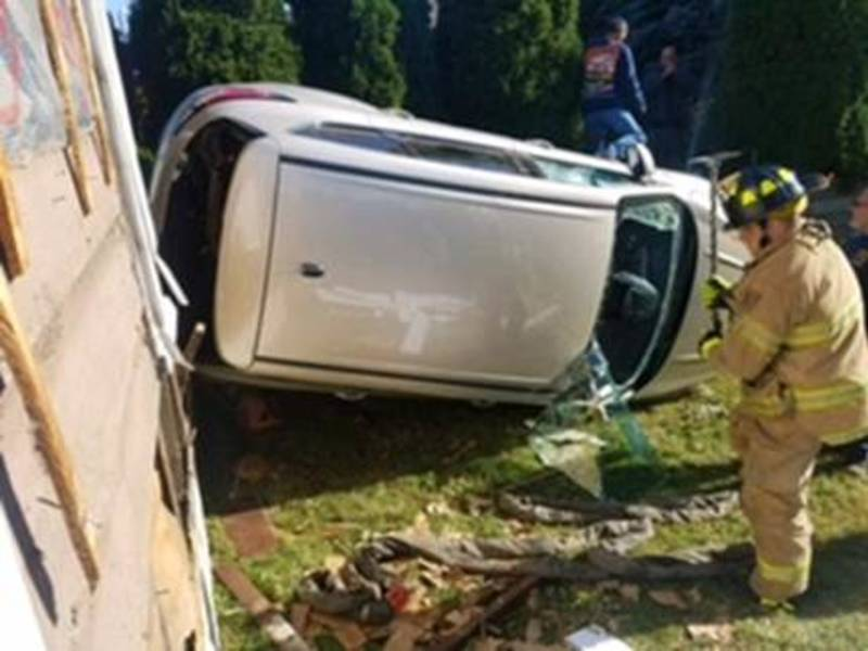 Nutley Rollover Crash; Car Collides With Storage Shed