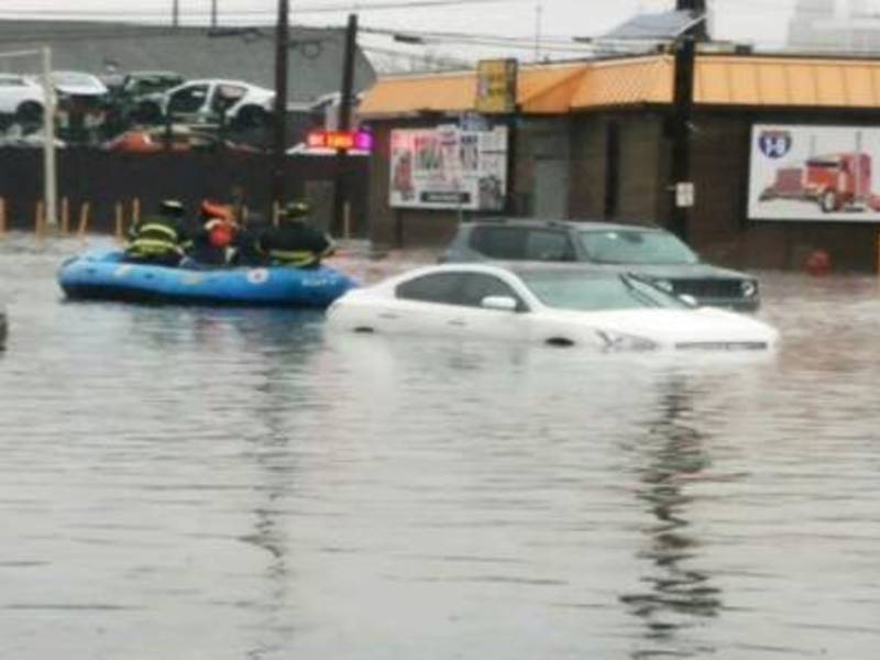 Boat Shelter Flood : Newark streets flood firefighters use boats to rescue