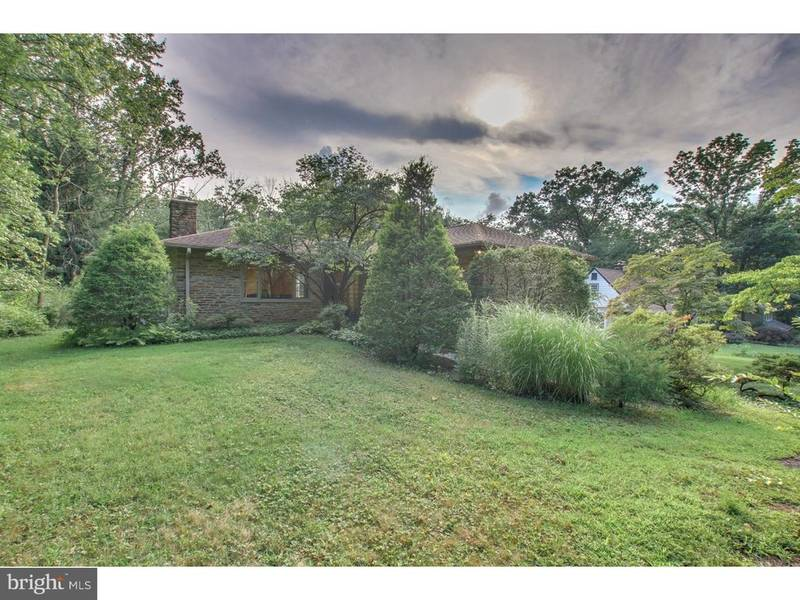 stone huntingdon valley home with covered patio deep backyard