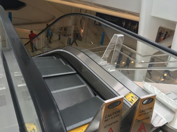 WTC escalator steps buckle, 2 men suffer minor injuries