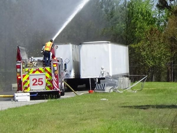 Firefighters in bring brush fire under control in Suffolk