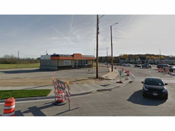 car dealership proposed for corner with adult bookstore