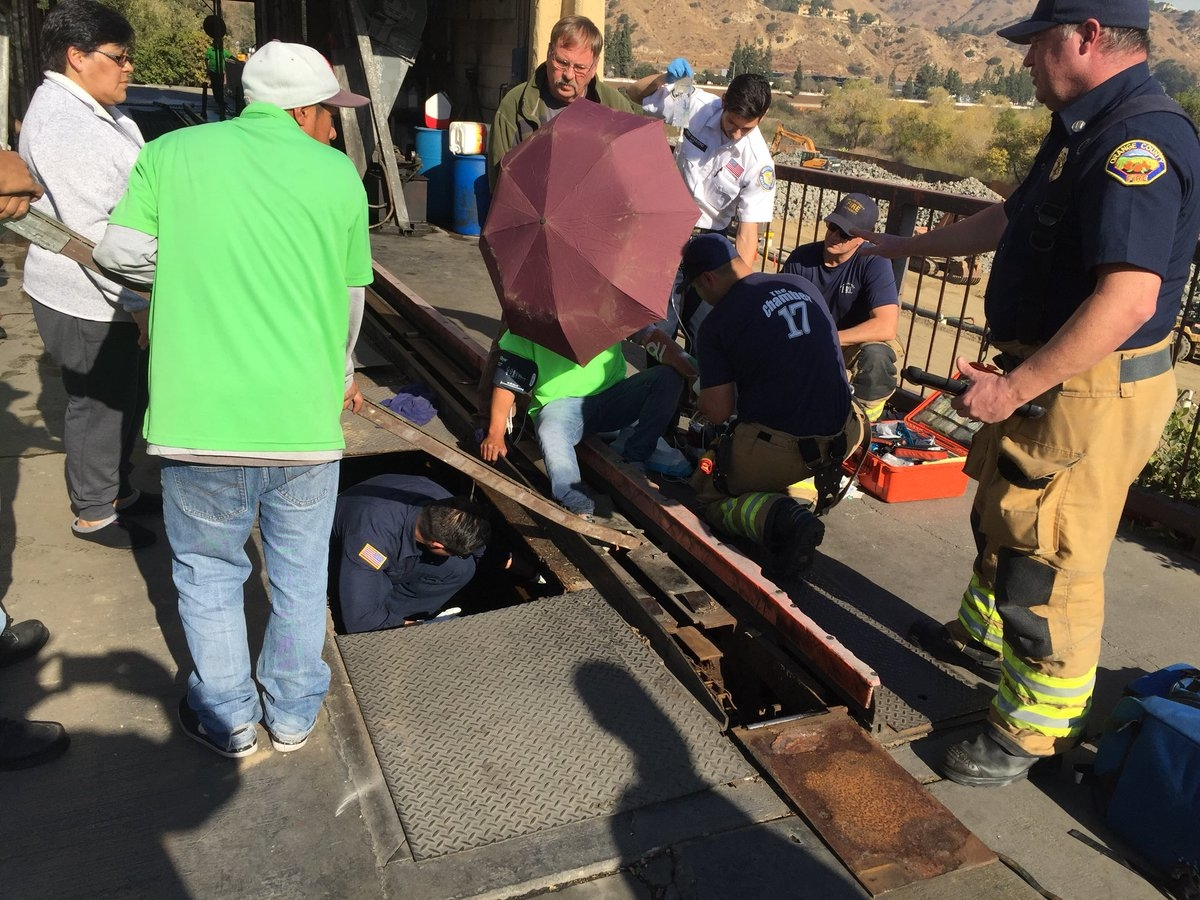 Oc firefighters free trapped man from car wash mission viejo ca ocfa photos solutioingenieria Choice Image