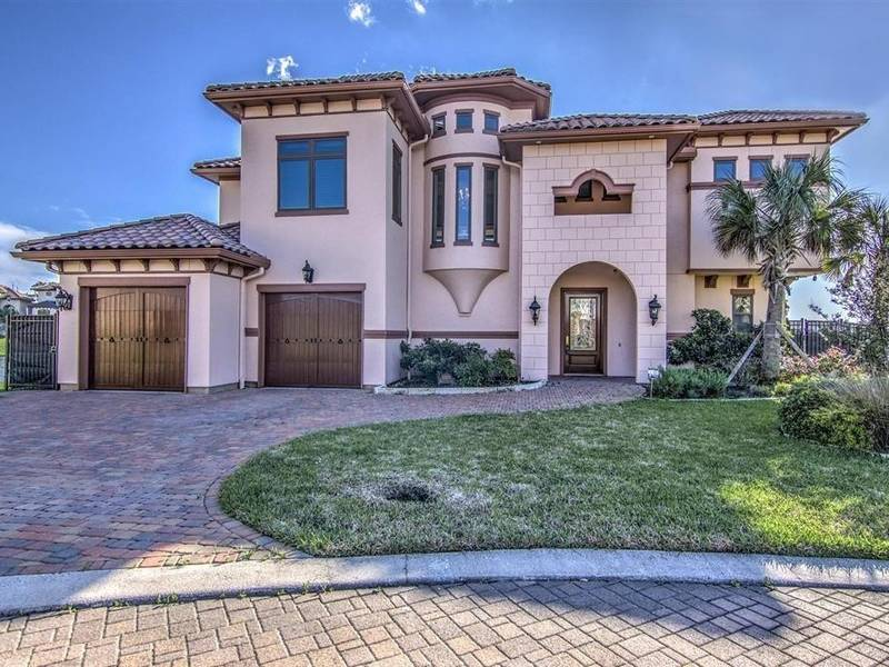 Ready For This Stunning Mediterranean-Style Villa On Lake Conroe?