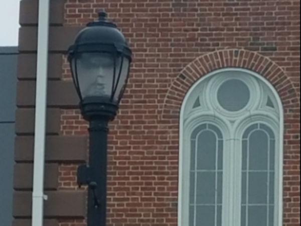 Mayor calls ghostly face seen in Salem streetlamp 'eerie'