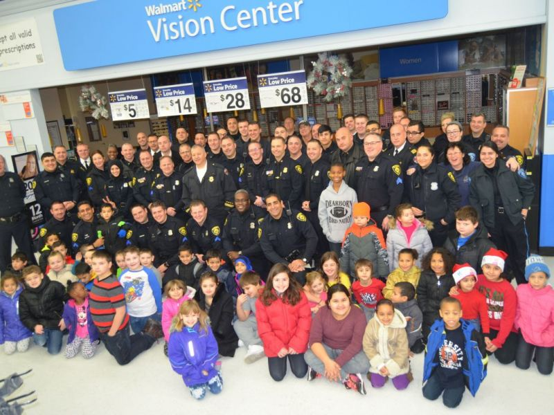 dearborn police officers and firefighters help deserving children shop for christmas gifts