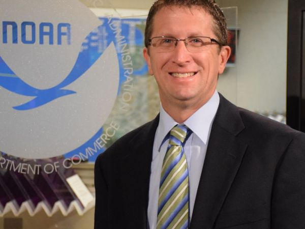 director of national hurricane center leaving for weather