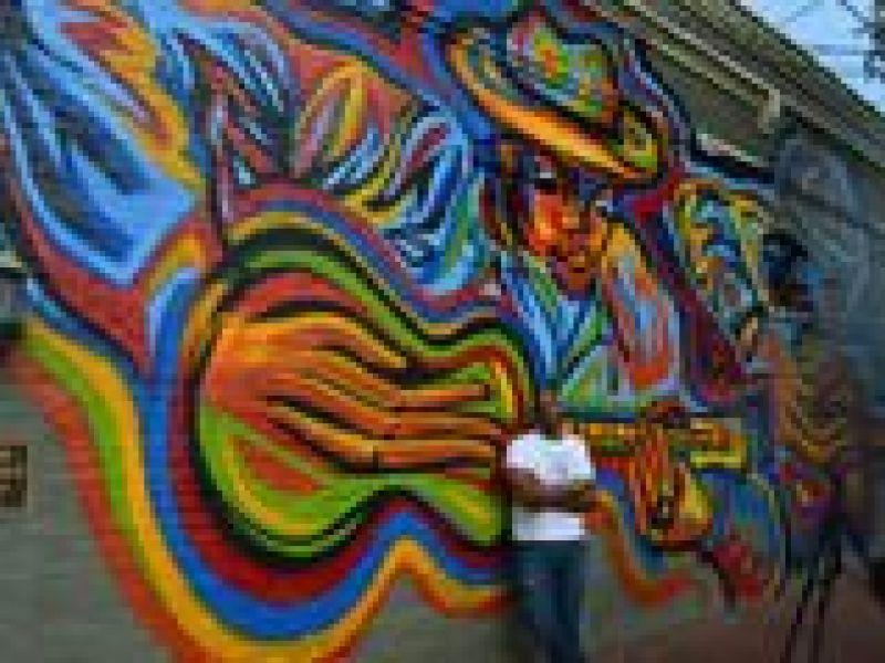 Atlanta artist corey barksdale creates a bold mural in for Atlanta mural artist