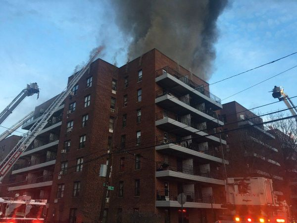 Firefighters battle 5-alarm fire at Queens building
