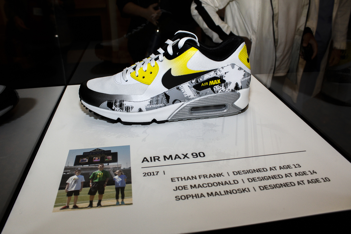 The new Nike designs created by three childhood cancer survivors can be  seen on this Air Max 90 sneaker. Photo: Travis Loose, Patch News