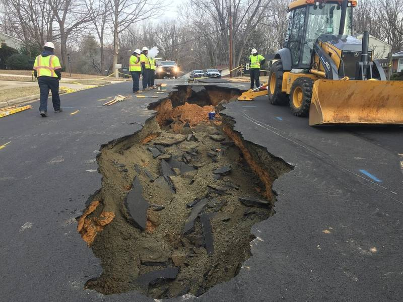 Massive sinkhole caused by water main break in fairfax for How much to build a house in northern virginia