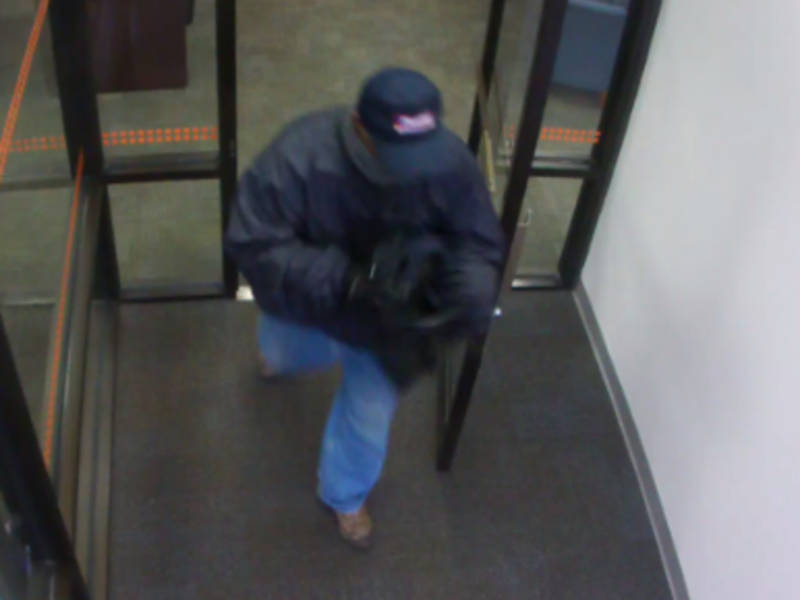 Bank Offers Reward For Robber's Conviction: Police