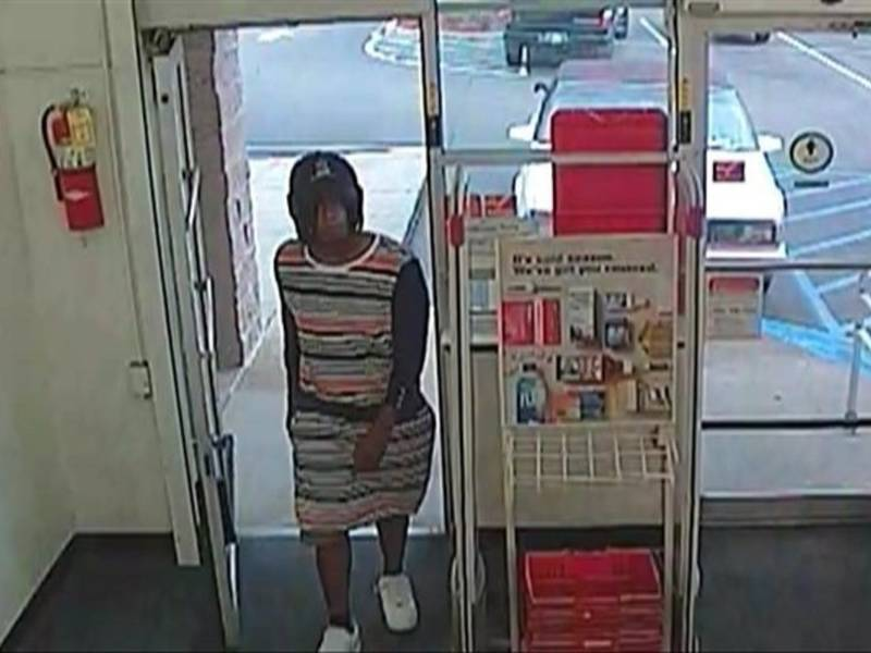 police search for male robbery suspect who dressed as woman