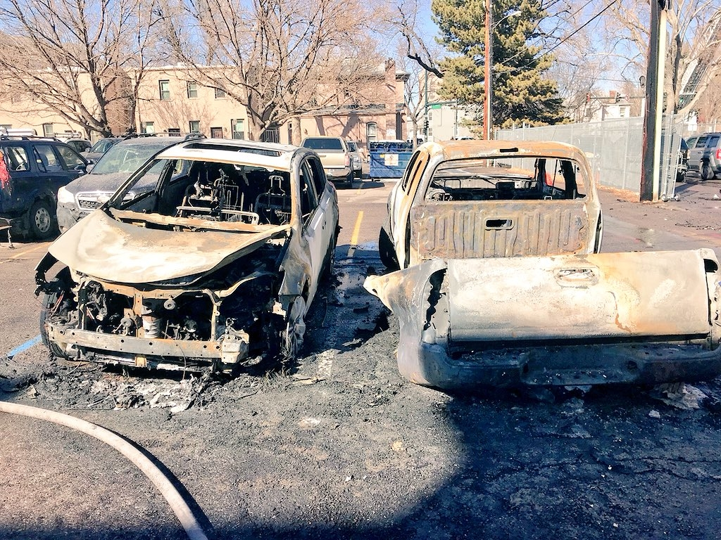 burned vehicles in the parking lot of a construction site fire at 18th and North Emerson Street in Denver. Via Denver Fire Dept.