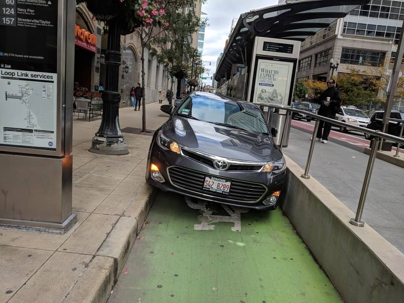 Oops Chicago Driver Wedges Car Into Bike Lane Despite Barriers