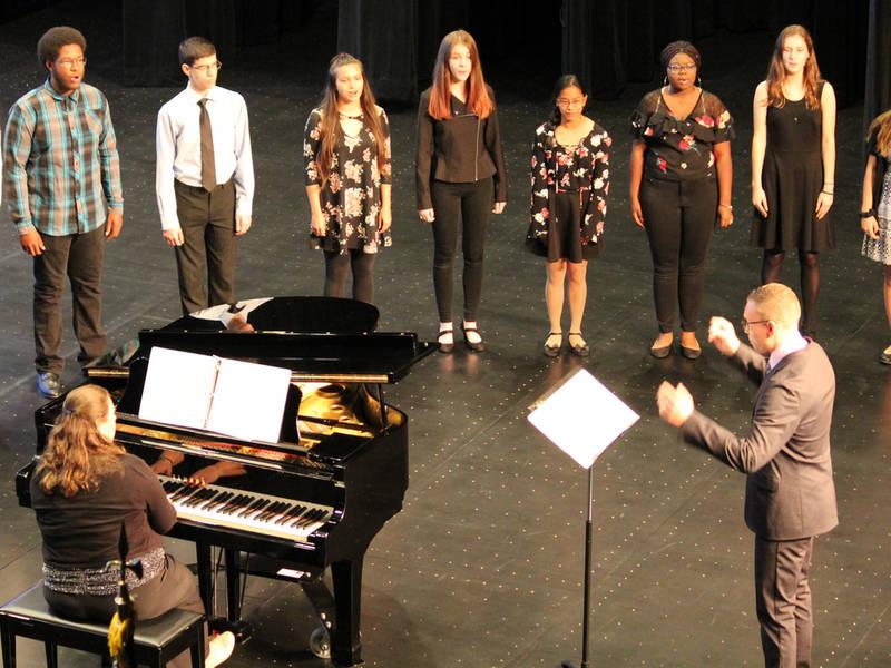 Video: Choir performing at PAC opening at Richards