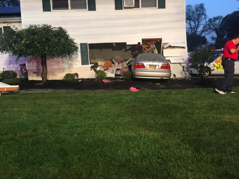 Driver, Resident Hurt After Car Crashes Into Long Island Home ...