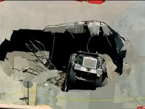 Dump Truck Plunges Into Parking Deck Hole In North Bergen