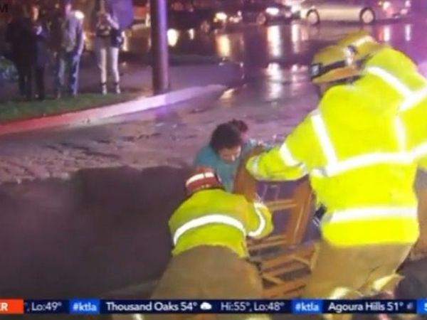 Woman rescued after sinkhole swallows vehicle